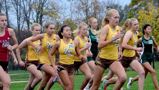 The Zeeland East girls cross country team claimed its first ever conference title on Wednesday at Helder Park.