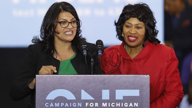 """In an Oct. 26, 2018, file photo, Rashida Tlaib, left, then-Democratic candidate for the Michigan's 13th Congressional District, and Brenda Jones speak during a rally in Detroit. Tlaib's approach to governing as an unapologetic fighter, taking aim at the status quo alongside three other first-term congresswomen of color who make up the """"squad"""" has made her a target of the GOP and her own party."""