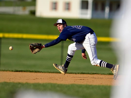 Dallastown's Riley Hamberger reaches for a ball in