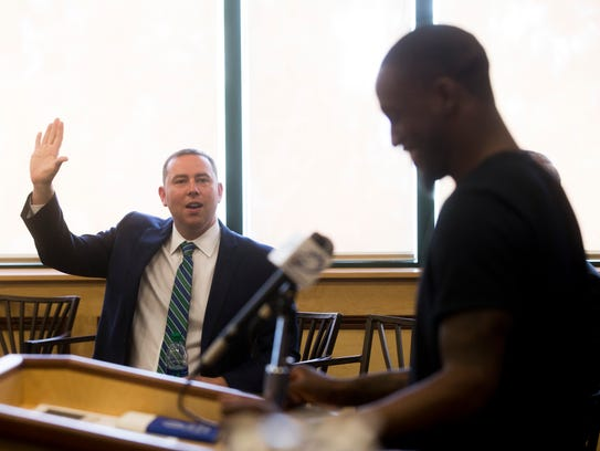 Newly-promoted FGCU head coach Michael Fly jokingly