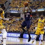 Atlanta Hawks guard Jeff Teague takes a shot against Indiana Pacers center Roy Hibbert and forward David West at Bankers Life Fieldhouse.