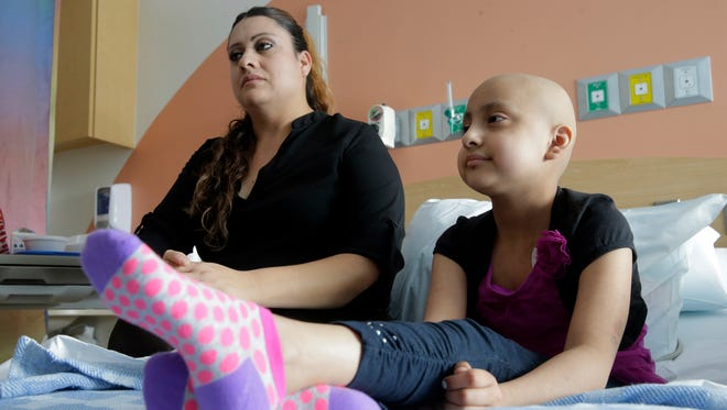 Maria Elena de Loera and her daughter Alia Escobedo 6, talk about the recent announcement by El Paso ChildrenÕs Hospital beening granted Institutional Membership by the ChildrenÕs Oncology Group (COG). For de Loera and her daughter means being able to get treatment for her here  inEl Paso and not having to go out of town.