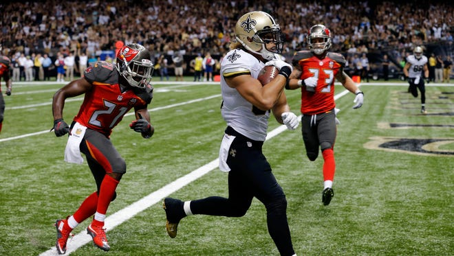 New Orleans Saints wide receiver Willie Snead scores on a touchdown reception in front of Tampa Bay Buccaneers cornerback Alterraun Verner (21) during an NFL football game in New Orleans. Saints coach Sean Payton sees several similarities between one of his favorite former New Orleans receivers, Lance Moore, and Snead, who has burst onto the scene with the Saints this year. Both pass-catchers play in the Superdome on Monday night when the Detroit Lions pay a visit.