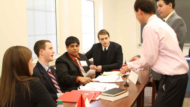 Students attending the Earlham Model United Nations conference Friday and Saturday at Earlham College will debate world issues, much as these participants in the 2013 conference did.