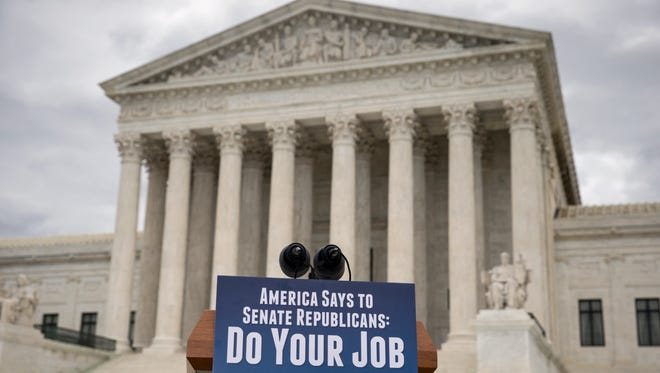 A sign is attached to a lectern before a news conference by Senate Democrats at the Supreme Court in Washington, D.C., on Feb. 25, 2016.