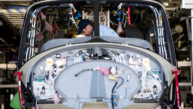 A worker helps to assemble a helicopter at AgustaWestland's aircraft manufacturing facility in Philadelphia.