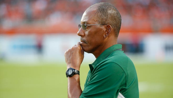 Florida A&M head coach Alex Wood watches play during the first half of an NCAA college football game against Miami, Saturday, Sept. 3, 2016 in Miami Gardens, Fla. (AP Photo/Wilfredo Lee)