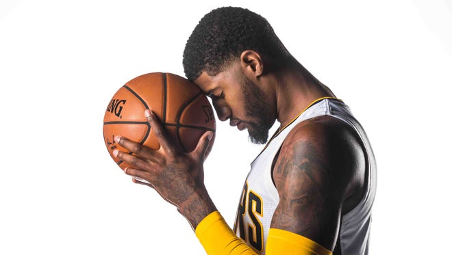 The Indiana Pacers Paul George, No. 13, poses for photos on Media Day at Bankers life Fieldhouse, Monday September 26th, 2016.