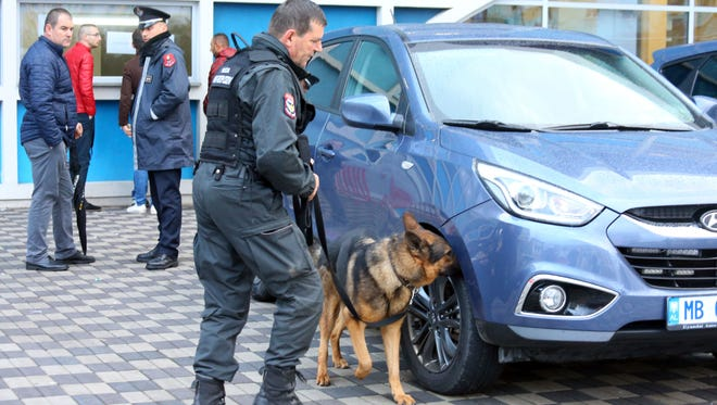 An Albanian policeman and police dog check cars in Elbasan, 50 miles south of the capital, Tirana, ahead of the 2018 World Cup Group G qualifying soccer match between Albania and Israel, on  Nov. 12, 2016. Police in Kosovo says Islamic terrorists planned to attack the match.