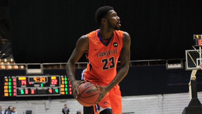 Evansville senior Willie Wiley looks to pass against Middle Tennessee on Sunday at Nashville Municipal Auditorium.