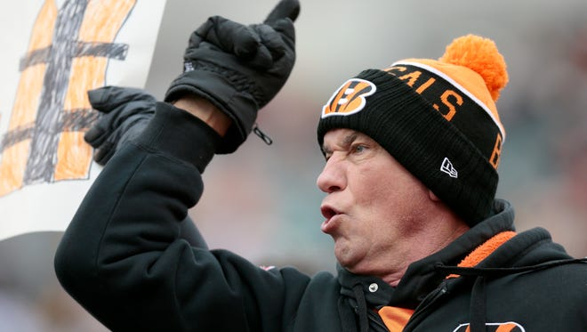 A Bengals fan cheers as the team takes the field before the first quarter of the NFL Week 15 game between the Cincinnati Bengals and the Pittsburgh Steelers at Paul Brown Stadium in downtown Cincinnati on Sunday, Dec. 18, 2016. At halftime the Bengals led 20-9.