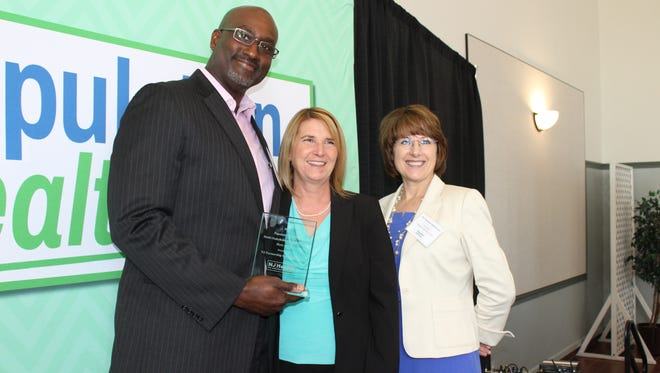 New Jersey Partnership for Healthy Kids (NJPHK) Deputy Director Dr. Darrin Anderson (left) with NJ Health Commissioner Cathleen Bennett (center) and co-director of Live Healthy Vineland/Executive Director of Partnerships and Community Development for Cumberland Cape YMCA Lisa Scheetz (right) after accepting the Population Health Hero awards.