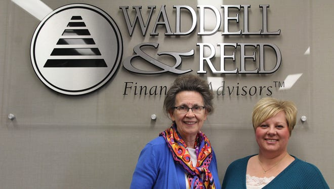 Financial advisers Judy Riesenberg (left) and Wendy Stroop offer no-pressure financial planning services at Waddell & Reed  Inc., Financial Services.