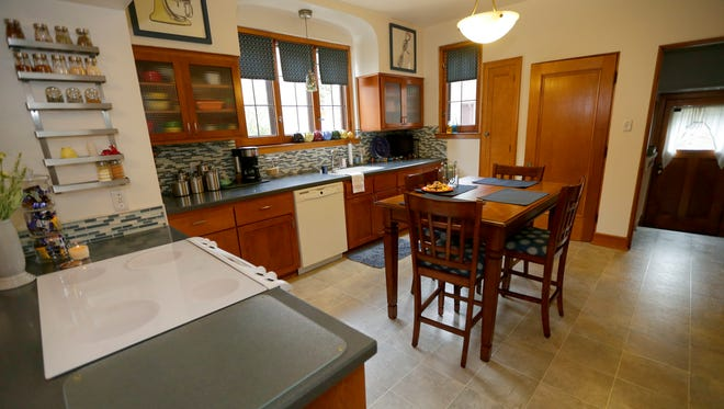 A completely remodeled the kitchen, adding new cabinets, countertops and backsplash.