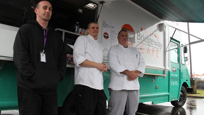 Jessy Powell, Matt Wangler and John Simmons stand outside Bridgeway's new food truck, the Rolling Bridgeway Cafe.