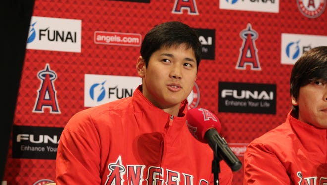 Angels pitcher and designated hitter Shohei Ohtani answers a question at a press conference at the Phoenix Marriott at The Buttes on February 14, 2018
