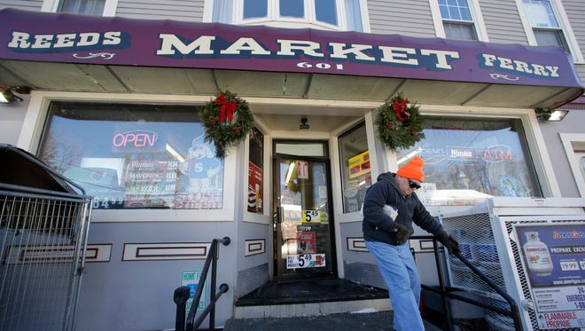 A customer departs Reeds Ferry Market convenience store, Sunday, Jan. 7, 2018, in Merrimack, N.H. AA Powerball ticket worth $560 million was sold at the store.
