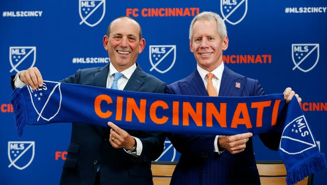 Major League Soccer commissioner Don Garber (left) poses with FC Cincinnati team owner Carl Lindner III after announcing the team's acceptance to the league at Rhinegeist Brewery in the Over-the-Rhine neighborhood of Cincinnati on Tuesday, May 29, 2018. FC Cincinnati was announced as the newest expansion team to join Major League Soccer.