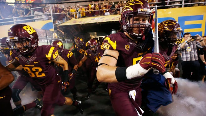 Arizona State players take the field at Sun Devil Stadium for Saturday's game against Stanford.