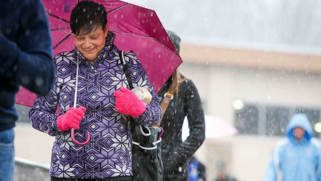Frozen sleet comes down as Rhonda Vichich of Newark heads to her car after finishing her workout at Hockessin Athletic Club.