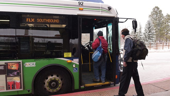 Passengers board a FLEX bus at the South Transit Center on Friday, February 24, 2017.