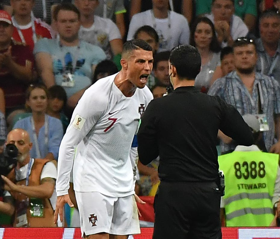 Portugal's Cristiano Ronaldo argues with Mexican referee Cesar Ramos during the match against Uruguay.