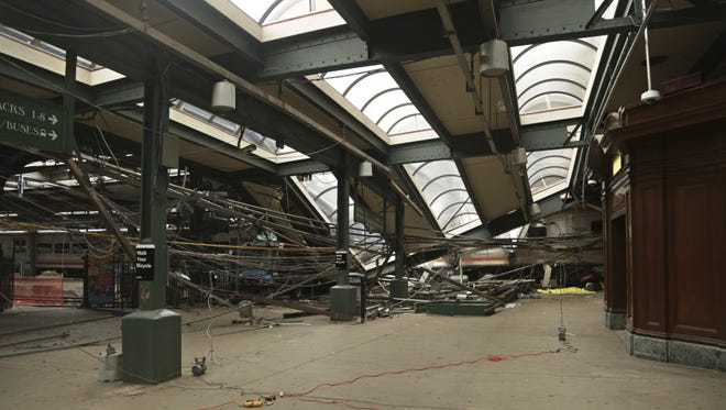 This Oct. 1, 2016, photo provided by the National Transportation Safety Board shows damage done to Hoboken Terminal in a commuter train crash that killed one person and injured more than 100 others.