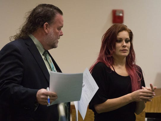 Josie Rubio speaks with her attorney Todd Holmes appearing