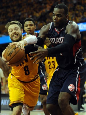 Cavaliers guard Matthew Dellavedova (8) fights  Hawks forward Paul Millsap (4) for the ball during the fourth quarter of Game 3 of the Eastern Conference finals at Quicken Loans Arena on Sunday.