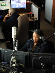 Dispatcher Charlene Rembert has her full attention on a developing situation at Monterey County Emergency Communications in Salinas.
