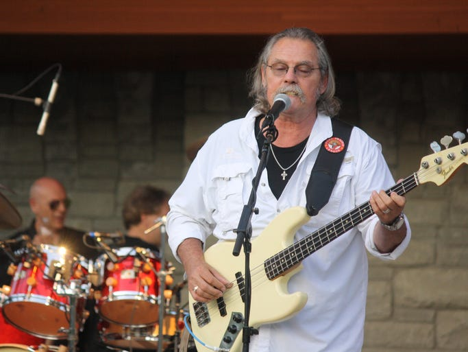 "Mike Reilly, bassist for Pure Prairie League, performs the hit song ""Amie"" in his hometown at the Fort Thomas Tower Park during the second Northern Kentucky Music Legends Hall of Fame induction ceremonies Thursday, June 5. Playing drums is 2014 inductee Mike Hodges, of Florence. The 2014 class of inductees were: Radio broadcaster Gary Burbank; Mickey Foellger and New Lime, Dennis Hensley of Jordan Recording Studio in Taylor Mill, Bill Hinds of Pure Prairie League, drummer Mike Hodges, backstage pass printer Dave Otto, and bassist Panny Sarakatsannis."