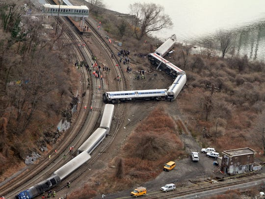 Emergency personnel work at the scene of a Metro-North