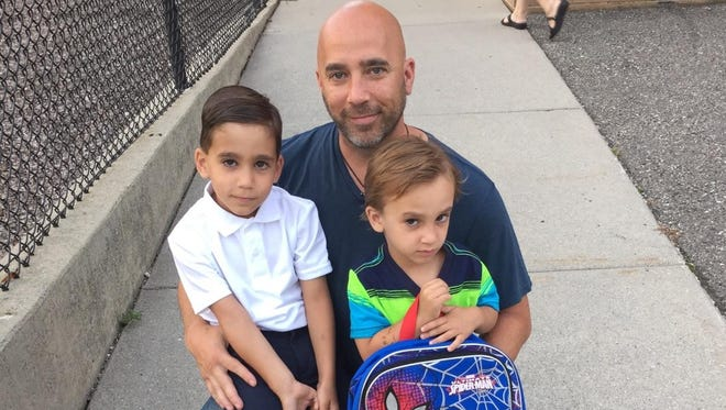 Sgt. Kenneth Steil with his sons William and Alexander.