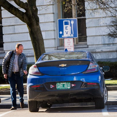 Not impressed: David Blittersdorf, president and CEO of Williston-based AllEarth Renewables, looks over an electric-vehicle charging station in late July 2014.