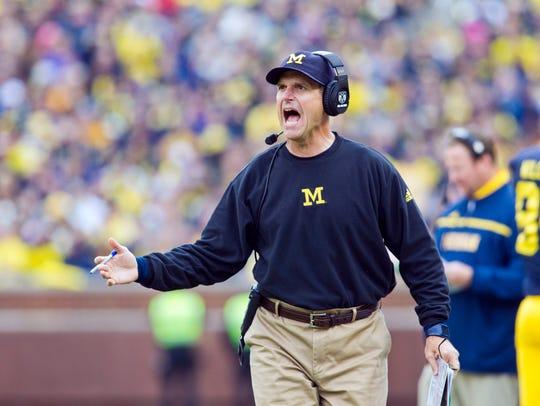 Michigan head football coach Jim Harbaugh has made a scholarship offer to a seventh-grade quarterback. AP FILE PHOTO