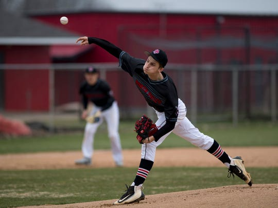North Posey's Shane Harris (17) delivers a pitch against the Carmi Bulldogs at North Posey High School Monday afternoon. North Posey got the win by beating Carmi 2-1.