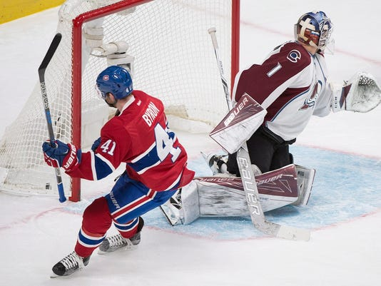 Montreal Canadiens' Paul Byron scores against Colorado Avalanche goaltender Semyon Varlamov during first period NHL hockey action in Montreal, Saturday, Dec. 10, 2016. (Graham Hughes/The Canadian Press via AP)