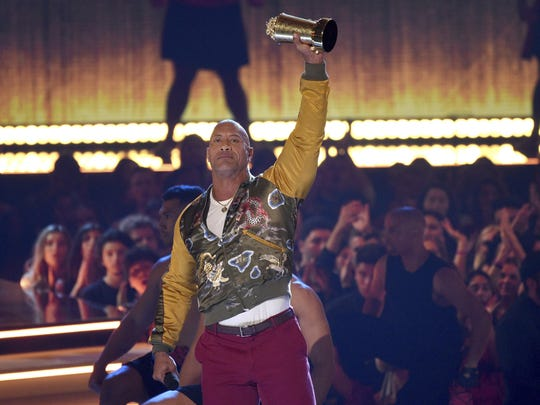 Dwayne Johnson, also known as The Rock, accepts the generation award at the MTV Movie and TV Awards on Saturday, June 15, 2019, at the Barker Hangar in Santa Monica, Calif.