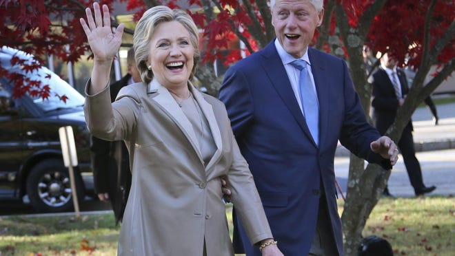 """FILE - In this Nov. 8, 2016, file photo, Democratic presidential candidate Hillary Clinton, and her husband former President Bill Clinton, greet supporters after voting in Chappaqua, N.Y. The Clintons announced Monday, Oct. 8, 2018, they will visit four cities in 2018 and nine in 2019 across North America in a series of conversations dubbed """"An Evening with President Bill Clinton and former Secretary of State Hillary Rodham Clinton."""""""