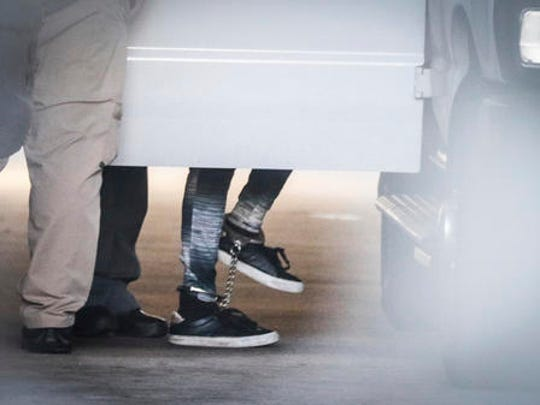 Dylann Roof, wearing shackles, is escorted into a transport vehicle in Charleston, S.C., on Thursday, Dec. 15, 2016 after he was found guilty of murdering nine parishoners at the Emanuel African Methodist Episcopal church. The same federal jury that found Roof guilty of all 33 counts will reconvene next month to hear more testimony and weigh whether to sentence him to death.