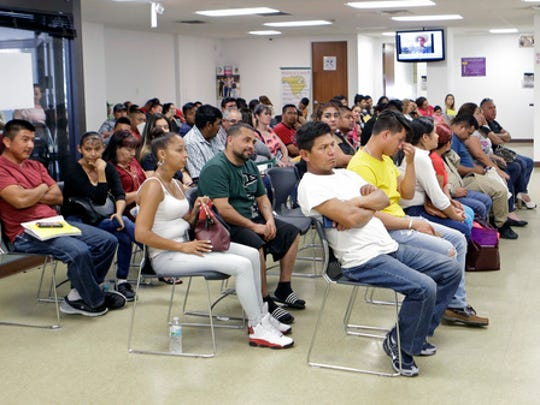 Mexican nationals wait to be seen at the Consulate