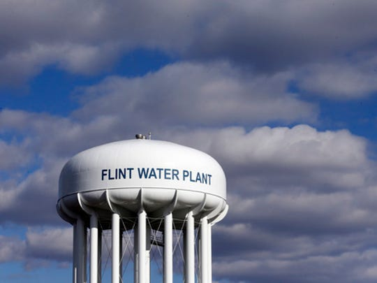 FILE - In this March 21, 2016 file photo, the Flint Water Plant water tower is seen in Flint, Mich. The Trump administration would slash programs aimed at slowing climate change and improving water safety and air quality, while eliminating thousands of jobs, according to a draft of the Environmental Protection Agency budget proposal obtained by the Associated Press.