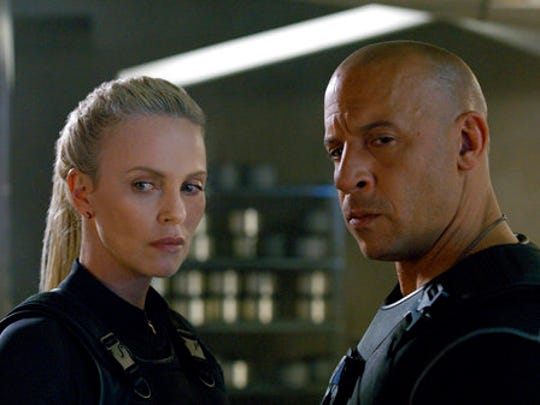"Charlize Theron, left, and Vin Diesel star in ""The Fate of the Furious."""