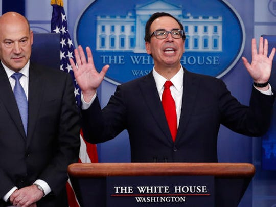 Treasury Secretary Steven Mnuchin, right, joined by National Economic Director Gary Cohn, speaks in the briefing room of the White House in Washington on April 26. President Donald Trump is proposing dramatically reducing the taxes paid by corporations big and small in an overhaul his administration says will spur economic growth and bring jobs and prosperity to the middle class.
