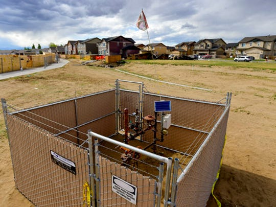 A well head is seen on Wednesday, April 26, 2017, in a fenced off area near a house that was destroyed in a deadly explosion in Firestone, Colo., April 17. Anadarko Petroleum said Wednesday it operated a well about 200 feet (60 meters) from the house in the town of Firestone. The company didn't say whether the well was believed to be a factor in the explosion or whether it produced oil, gas or both.