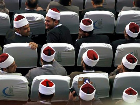 Muslim scholars wait for the meeting between Pope Francis and Sheikh Ahmed el-Tayeb, Al-Azhar's grand imam, in Cairo Egypt, Friday, April 28, 2017. Francis is in Egypt for a two-day trip aimed at presenting a united Christian-Muslim front that repudiates violence committed in God's name.
