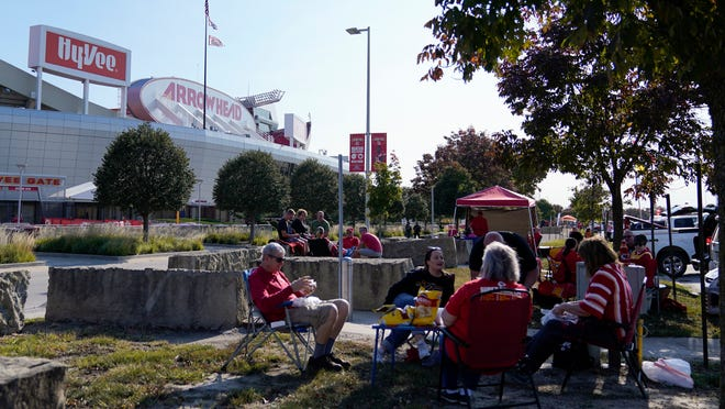 Fans tailgate outside Arrowhead Stadium before Monday night's game between the Kansas City Chiefs and the Patriots in Kansas City.