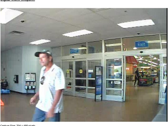 Surveillance image of a man who used a stolen credit