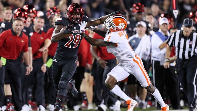 Louisville's Malik Williams gains yardage in the first half and is brought down by Clemson's Trayvon Mullen.September 16, 2017
