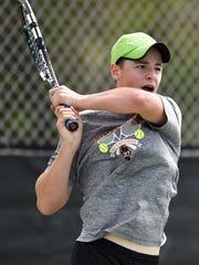 Lincoln Park Academy's Cameron Slack returns the ball